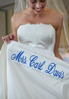 Sewing your married name in blue onto the hem of your dress. Great idea to share!