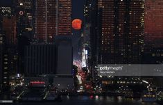 The Strawberry Moon rises above Street in New York City on June as seen from Weehawken, New Jersey. (Photo by Gary Hershorn/Getty Images) 42nd Street, New York Street, World Bodypainting Festival, Strawberry Moons, Festival Image, Moon Photos, Moon Rise, Rise Above, Science And Nature