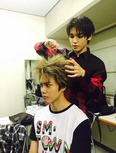 "Taeyong and Hansol Bahahahahaha love Hansol's face his like ""what did you do to my hair you freak"" #SMROOKIES"