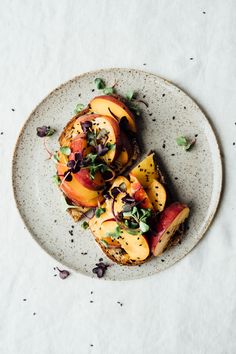 1/4 cup tahini, well stirred 1 tablespoon raw honey, plus extra for serving 1/2 teaspoon salt 2 pieces of whole grain toast 2 peaches, sliced into wedges black sesame seeds and radish sprouts