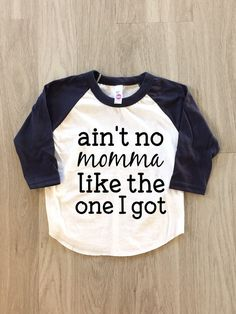 This American Apparel aint no momma like the one I got Raglan tshirt is perfect for your favorite little sidekick! These super soft, lightweight raglans are made of 50% cotton and 50% polyester with high quality heat transfer vinyl which is durable enough for anything your babe can get in to!  **If you are interested in another color besides a black design, please message me for details.**  This is the American Apparel size chart, but in my opinion, the shirts do run a little big.  Size…