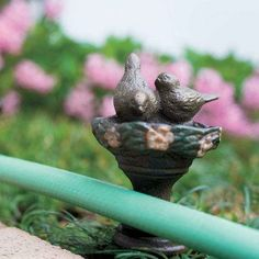 Cast Iron Garden Hose Guides – The decorative hose guides rotate so your hose will glide around your flowerbed.