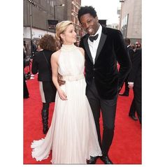 Dianna agron on a red carpet with a friend