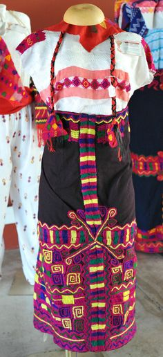 Maya Textiles Chiapas Mexico. Huipil and embroidered skirt from Venustiano Carranza, a Maya community in Chiapas, Mexico. Made by Dominga Mendoza Vasquez. Part of the Grandes Maestros exhibition at the Oaxaca State Folk Art Museum (MEAPO)