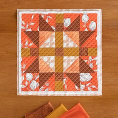"A quick cheat for quilting with bright colors during the fall and winter seasons is choosing the right hue! Pick your favorite pinks with a cooler (blueish) undertone for the winter seasons, or choose some bright oranges that are warmer (reddish) undertone for fall. With this concept in mind, we made our ""Continental"" quilt block merging analogous colors from cool pinks to warm oranges. This goes for any color so have fun experimenting with greens, blues, and purples too!"