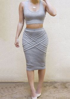 This  figure-flattering grey crisscross skirt co-ord set comes with a tank crop top which is designed with a scoop neckline and a racerback, and a knee-length skirt that has crisscross bandage detailing at front. | Lookbook Store Co-ords
