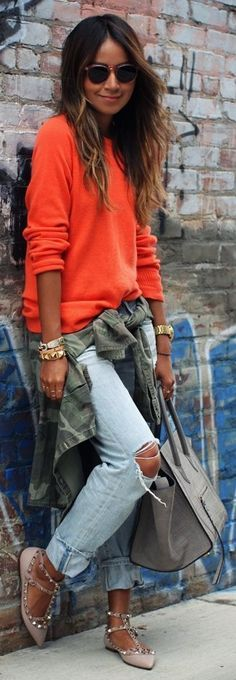 An olive camo military jacket and light blue destroyed boyfriend jeans are a perfect combination to be utilised at the weekend. Elevate your getup with grey leather flats. Shop this look on Lookastic: https://lookastic.com/women/looks/military-jacket-crew-neck-sweater-boyfriend-jeans/17723 — Orange Crew-neck Sweater — Gold Bracelet — Gold Watch — Light Blue Ripped Boyfriend Jeans — Olive Camouflage Military Jacket — Grey Leather Tote Bag — Grey Leather Ballerina Shoes — Black Sung...