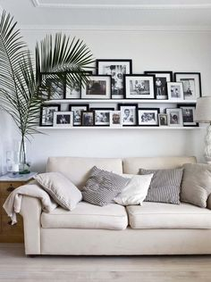 Photo wall - never worry about hanging the photos straight again and you can put tons of them on the shelves.
