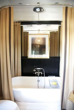 love the shower curtain ring detail and the  rain showerhead mounted above the tub