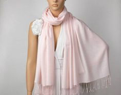 Pale pink pashminas for the ladies would be a nice touch in case it is a tad cool or damp (inexpensive gift:  $5 each)