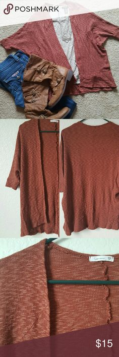"""Soprano rust knit swing cardigan Soprano from Nordstrom rust colored knit swing cardigan. Dolman sleeves.   Cotton/rayon/spandex blend   Size small. But will fit medium too. Can't really measure bust due to style. Length is 27"""" Soprano Sweaters Cardigans"""