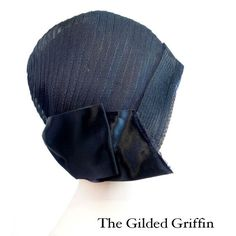 Authentic Flapper's Cloche Vintage Hat circa 1929 The hat is obviously designed for the most closely cropped hairstyles and it entirely envelopes the head and surrounds the face. It entirely covers the ears and the entire head to the very base of the skull.