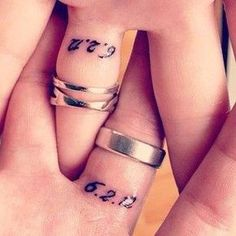 """33 Impossibly Sweet Wedding Ring Tattoo Ideas You'll Want To Say """"I Do"""" To...not sure if I would ever do this, but I love the date on the inside, under your rings"""