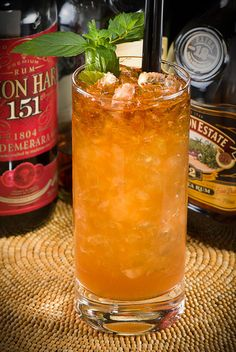 Zombie Punch: ¾ oz fresh lime juice, ½ oz Don's Mix*, ½ oz falernum (Fee Brothers), 1½ oz gold Puerto Rican rum (Bacardi 8), 1½ oz aged Jamaican rum (Appleton 12), 1 oz Lemon Hart 151 demerara rum, 1 dash Angostura bitters, 6 drops (⅛ oz) Pernod (Kübler absinthe), 1 tsp grenadine, ¾ C crushed ice, mint to garnish.  Shake all ingredients with ice, then strain into a tall glass filled with crushed ice. Top up the glass as needed with ice cubes. Garnish with a mint sprig.
