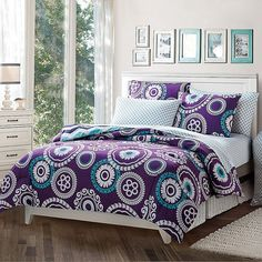 Victoria Classics Malibu Bed Set (Purple) ($83) ❤ liked on Polyvore featuring home, bed & bath, bedding, purple, purple pillow cases, floral twin xl bedding, twin extra long bedding sets, purple bedding and twin xl bedding