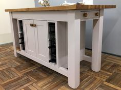 Useful storage & display are combined in this island design. It incorporates a double cupboard flanked by wine storage racks, 2 end cutlery drawers, an oak slatted display shelf plus a long breakfast bar along one side. Shown here finished in Farrow & Ball Peignoir Estate Eggshell finish & in an overll size of L:1600mm D:900mm H:910mm but any size or colour is available to order. Painted Kitchen Island, Kitchen Islands, Wine Rack Storage, Freestanding Kitchen, Island Design, Eggshell, Farrow Ball, Display Shelves, Cutlery