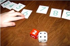 "Montessori Tidbits: Advanced counting with dice. Count red die first then continue with dotted die:  ""2, 3, 4, 5, 6."" Then find corresponding written number."