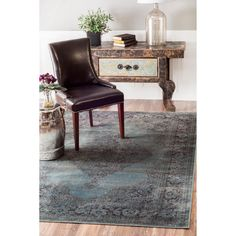 This vintage-style viscose rug brings a classic look to your contemporary living space. The ultra-soft faux silk surface feels great on bare feet, and the unique design is sure to garner plenty of compliments from friends and family alike