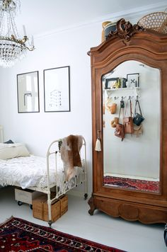 kids room, wardrobe, vintage furniture, rug, iron frame bed, white walls, simple, interior, home, bedroom, storage, mirror, bag rack