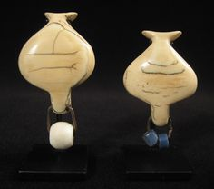 """Two rare ivory lip plugs from Southern Tanzania. Early 20th century. with a white glass bead, measures 2.5"""" high by 1.5"""" wide. with two blue glass beads, measures 3"""" high by 1.5"""" wide"""