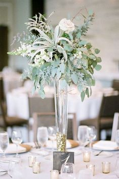30 Sophisticated Tall Wedding Centerpieces A wedding centerpiece is a must for literally any table, whatever it's made of. But the main disadvantage is that a centerpiece takes much table space. Modern Wedding Centerpieces, Wedding Table Centerpieces, Wedding Flower Arrangements, Floral Centerpieces, Wedding Favors, Wedding Decorations, Centerpiece Ideas, Summer Centerpieces, Diy Wedding