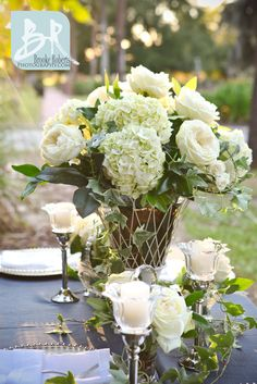 Cream Garden roses and hydrangeas at an outdoor wedding reception. Southern styled.