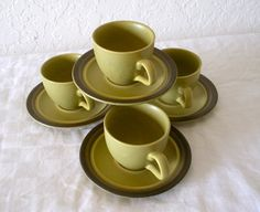 Set of 4 Espresso Cups - Arrowstone Kasuga Japan -creamy sage green. $18.00, via Etsy.