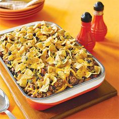 Layer a spicy ground beef mixture with kidney beans, olives, cheese and corn chips and bake for a main dish casserole that will satisfy...