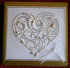 ED054 Valentine heart on Craftsuprint designed by Emy van Schaik - made by Gail Pennycuick - I printed the pattern onto matte card and used it as a template to prick the design onto a white square textured card piece. I followed the stitching guide using gold metallic thread and white pearl beads. When finished I layered it onto a gold square card and used gold peel-offs to form a border around the heart. Finally I added a small organza bow with pearl in one corner. This beautiful design ...