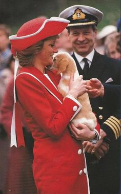 The Princess of Wales arrived at the annual passing-out parade at the Britannia Royal Naval College in Dartmouth. She was dressed in a bright red Catherine Walker military inspired coat dress with naval style striped collar and a Philip Sommerville red straw tricorn hat with a gross grain bow and long ribbon trim at the back.