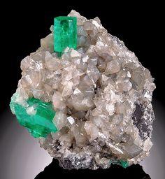 Beryl var. Emerald on shiny gray Calcite crystals -- Coscuez Mine, Mun. de Muzo, Vasquez-Yacopí Mining Dist., Boyacá Depart., Colombia