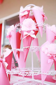 Use a cupcake stand to hold handmade cones, that can hold cotton candy, popcorn or whatever hand snacks
