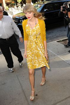 Taylor Swift changes into a red dress as she heads to Sirius Radio to continue promoting her new album