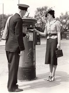 A lady posts a letter into a King George VI Pillar Box. A postman stands next to the pillar box and points to the collection schedule. Date: 1938 BPMA reference: POST Vintage Inspired Fashion, 1930s Fashion, Art Deco Fashion, Antique Photos, Old Photos, Vintage Photos, Old London, North London, Tarzan