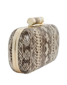 Inge Christopher' Lia clutch exudes refined elegance. Made with genuine water-snake, this gorgeous minaudiere is a versatile statement bag. You can dress it up as a stylish snakeskin clutch for a special occasion or dress it down for date night. Wear it as a chic crossbody bag or remove the chain to carry it as a glamorous minaudiere.