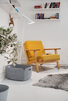 AJ floor lamp by Louis Poulsen, Restore basket by Muuto, Wooden Monkey by Kay Bojesen. Picture from Alvhem Mäkleri.