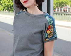 Very elegant way to refashion a sweat shirt. Add cross stitch fabric on shoulders & make short or long sleeved