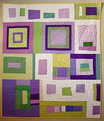 I have come to the conclusion that there are very few purple and green quilts out there that I like.  This is one of the beautiful exceptions.