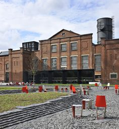 The C-Mine square, situated on a former coalmining site,  is the central open space of the new cultural centre of Genk. Most of the buildings around the square are former mining buildings, renovated and transformed into buildings with a cultural program.