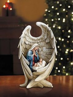 Madonna And Child In Angel Wings Made of Resin Measures The Virgin Mary looks on adoringly, hands in prayer, at her infant son Jesus Christ, while enfolded within the protection of an angel's win Christmas Nativity Scene, Christmas Time, Christmas Crafts, Christmas Decorations, Angel Decor, Angel Art, Image Jesus, Blessed Mother Mary, Jesus Pictures