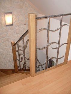 Gamme prestige : Escalier chêne avec feronnerie d'art type vague