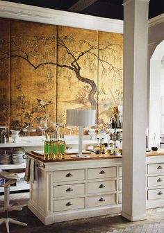 gold chinoiserie panels in the kitchen. stunning
