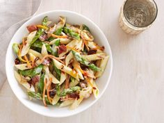 Primavera with Prosciutto, Asparagus and Carrots: Ted Allen adds bits of salty prosciutto to a creamy sauce for an ultra-decadent take on the classic dish.