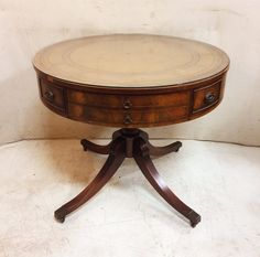 Large Vintage Round Drum Table with Glass Covered Embossed Leather Top, Pedestal Base and Drawer $285