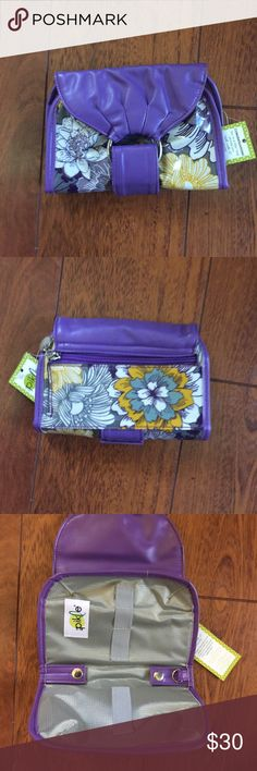 "In A Pickle Purse Organizer - Purple Posey. - Brand New with tags. - Fashionable compact organizer for    essential convenience items needed    for lifes daily emergencies. - vibrant colors make this one of a kind     Bag. - 10""x7"" open - 3""x5"" closed - buckle is adjustable. - clear PVC over lay so it's easy to clean. - comes with 8 pouches and a credit     card holder. PRICE FIRM unless bundled! In A Pickle Bags Clutches & Wristlets"
