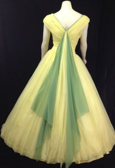 Vintage 1950s ball gown Yellow Prom Dress formal tulle Full skirt Ruched Sleeveless Princess. $300.00, via Etsy.