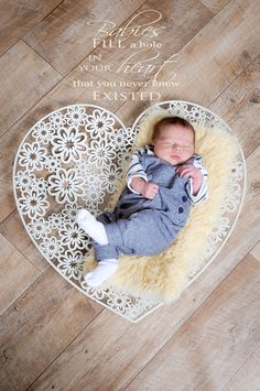 A newborn portrait using our heart prop and a little newborn quote