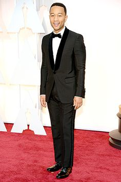 """The Best Song winner (for Selma's """"Glory"""") looked handsome in his Gucci suit."""