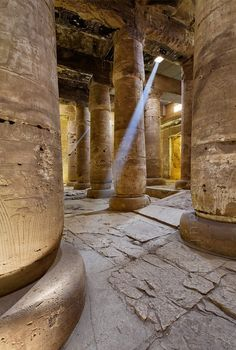 Second Hypostyle Hall of Seti I Temple at Abydos. A sun beam piercing through a a hole in the roof illuminates the temple. Ancient Egyptian Architecture, Architecture Antique, Ancient Ruins, Ancient History, Egypt Art, Ancient Civilizations, Gods And Goddesses, Luxor, Archaeology