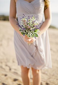 Brides.com: . A colorful posy comprised of lavender and lily of the valley, created by Blossoming Blessings.
